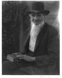 Man Holding a Bible, Photograph Number 3... by Ulmann, Doris