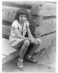 Small Girl Seated by Log Cabin, Number 1... by Ulmann, Doris