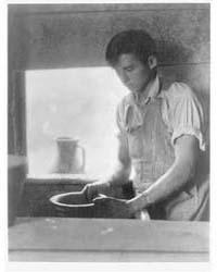 Man Working at a Pottery Wheel, Photogra... by Ulmann, Doris