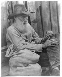 Old Man Holding Potato, Photograph Numbe... by Ulmann, Doris