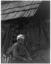 Old Man Seated in Front of Log Cabin, Ph... by Ulmann, Doris