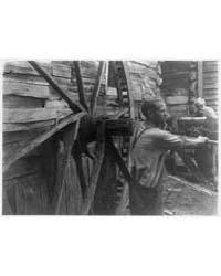 Two Men Operating a Lathe, Photograph Nu... by Ulmann, Doris