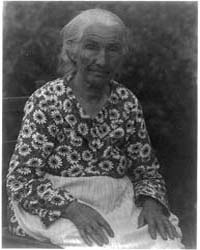 Old Woman in a Flowered Print Dress, Pho... by Ulmann, Doris